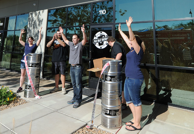 Beth Dominiak, Weston Barkley, Nathan Hall, Mike Dominiak and Amber Barkley, left to right, welcome the people at the opening of Bad Beat Brewing in Henderson, Friday, July 11, 2014. The brew hous ...