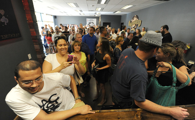 Patrons line up for beer at Bad Beat Brewing in Henderson, Friday, July 11, 2014. The brew house opened on Friday to large crowds.  (Jerry Henkel/Las Vegas Review-Journal)