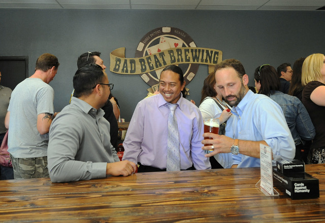 Eddie Sanchez, Ron Bato, and Joe Carque, left to right, enjoy the camaraderie and beer at the grand opening of Bad Beat Brewing in Henderson, Friday, July 11, 2014. The brew house opened on Friday ...