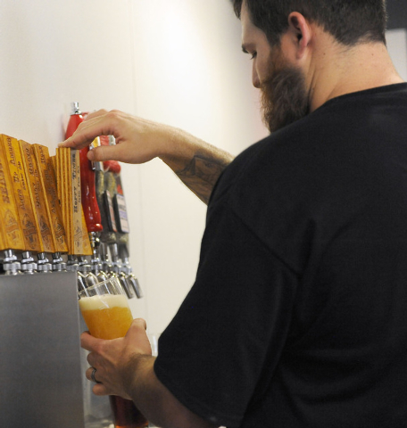 Weston Barkley draws a beer at Bad Beat Brewing in Henderson, Friday, July 11, 2014. The brew house opened on Friday to large crowds.  (Jerry Henkel/Las Vegas Review-Journal)