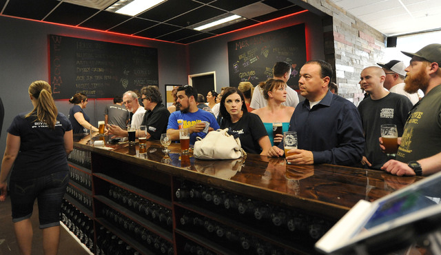 Patrons wait at the bar for beer at Bad Beat Brewing in Henderson, Friday, July 11, 2014. The brew house opened on Friday to large crowds.  (Jerry Henkel/Las Vegas Review-Journal)