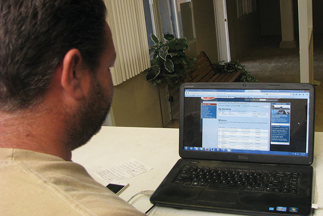East Valley resident Ben Andreas checks out stats on a fantasy fishing website between working with customers at  the Sunshield Awning Company, 4685 Boulder Highway. He's owned the company his fat ...