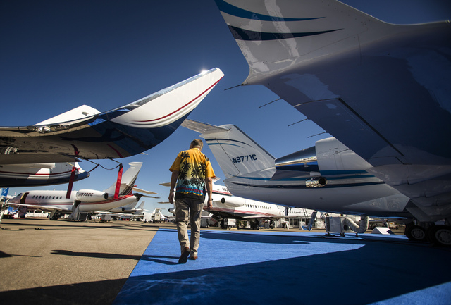 A man walks through the National Business Aviation Association Static Display of Aircraft on Tuesday, Oct. 22, 2013 at Henderson Executive Airport. The tradeshow which attracts 25,000 ends on Thur ...