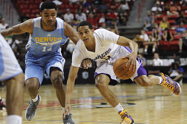The Lakers' Jordan Clarkson (5) drives past Denver's Gary Harris (14) during their NBA Summer League consolation round game at the Thomas & Mack Center in Las Vegas on Friday, July 18, 2014. (Jaso ...