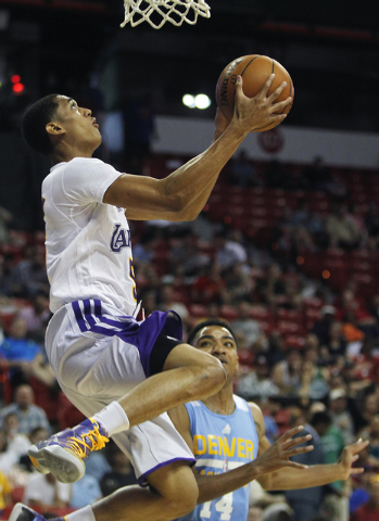 The Lakers' Jordan Clarkson (5) drives to the basket past Denver's Gary Harris (14) during their NBA Summer League consolation round game at the Thomas & Mack Center in Las Vegas on Friday, July 1 ...