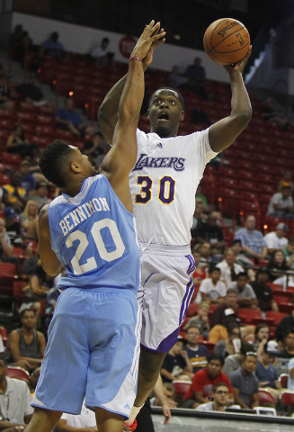 The Lakers' Julius Randle (30) shoots over Denver's Jerelle Benimon (20) during their NBA Summer League consolation round game at the Thomas & Mack Center in Las Vegas on Friday, July 18, 2014. (J ...