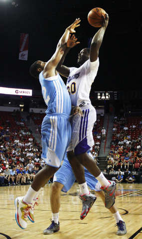 The Lakers' Julius Randle (30) shoots over Denver's Will Thomas (32) during their NBA Summer League consolation round game at the Thomas & Mack Center in Las Vegas on Friday, July 18, 2014. (Jason ...