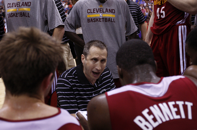 Cleveland head coach David Blatt, middle, offers instructions to second year player Anthony Bennett during their NBA Summer League game at the Cox Pavilion in Las Vegas on Friday, July 11, 2014.(J ...