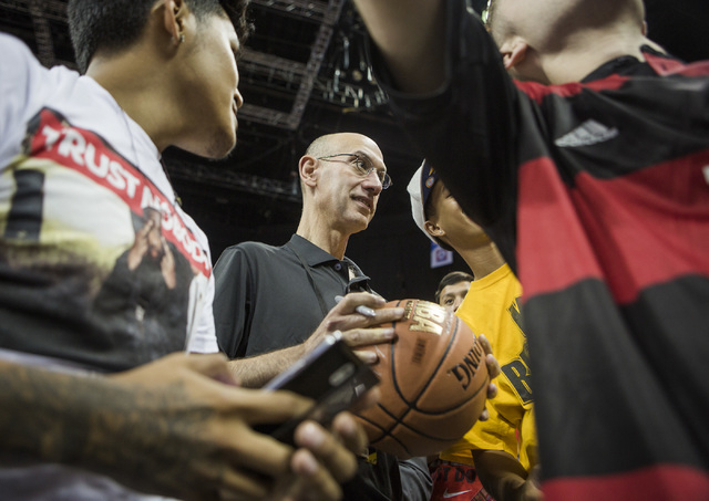 NBA commissioner Adam Silver signs autographs before the San Antonio Spurs vs New Orleans Pelicans NBA Vegas Summer League game at Thomas & Mack on Monday, July 14, 2014. This year's VSL has 24 te ...