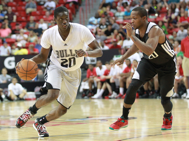 Chicago's Tony Snell, left, drives the ball against Sacramento's Ra'Shad James during an NBA Summer League quarterfinal game at the Thomas & Mack Center in Las Vegas on Saturday, July 19, 2014. (C ...