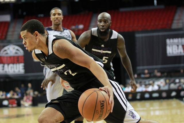 Sacramento's Nik Stauskas (10) drives the ball against Washington during an NBA Summer League semifinal game at the Thomas & Mack Center in Las Vegas on Sunday, July 20, 2014. (Chase Stevens/Las V ...