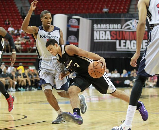 Sacramento's Ray McCallum (3) drives against Washington's Kwame Vaughn (5) during an NBA Summer League semifinal game at the Thomas & Mack Center in Las Vegas on Sunday, July 20, 2014. (Chase Stev ...
