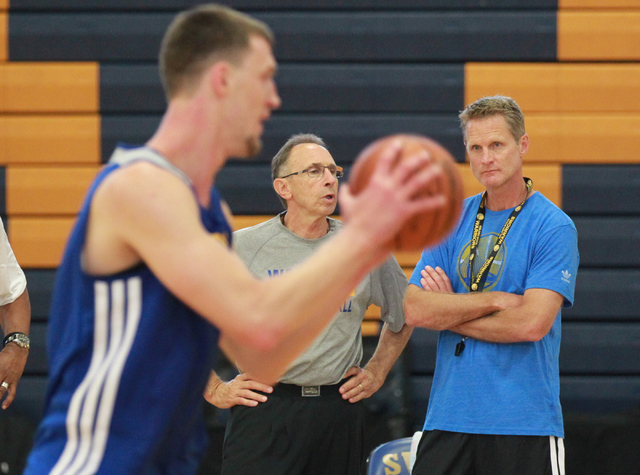 Golden State Warriors Head Coach Steve Kerr, right, watches the action during practice with Ron Adams, assistant coach, at Sierra Vista High School in Las Vegas on Tuesday, July 8, 2014. (Chase St ...