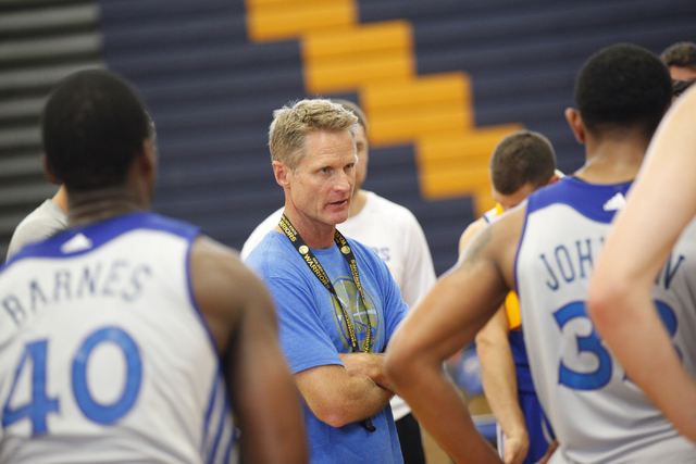 Golden State Warriors Head Coach Steve Kerr, center, talks with the team at the end of practice at Sierra Vista High School in Las Vegas on Tuesday, July 8, 2014. (Chase Stevens/Las Vegas Review-J ...