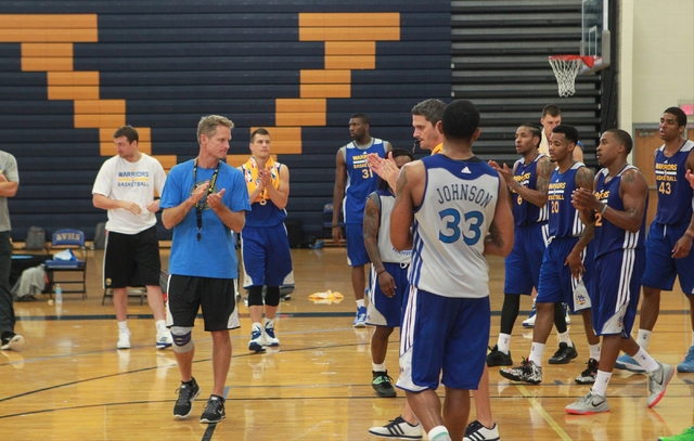 Golden State Warriors Head Coach Steve Kerr, left, claps at the end of practice at Sierra Vista High School in Las Vegas on Tuesday, July 8, 2014. (Chase Stevens/Las Vegas Review-Journal)