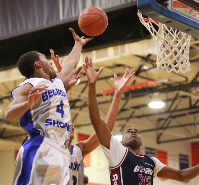 Belmont Shore's Nick Blair (4) reaches to tip in a shot as Upward Stars' Malik Dunbar (35) attempts to block during a basketball game in the Fab 48 tournament at Bishop Gorman High School in Las V ...