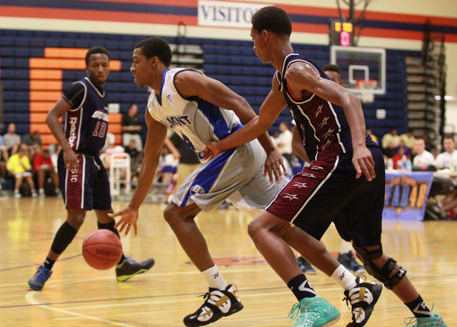 Belmont Shore's Nick Blair (4) drives the ball as Upward Stars' PJ Dozier, right, defends and Randall Shaw (1) looks on during a basketball game in the Fab 48 tournament at Bishop Gorman High Scho ...
