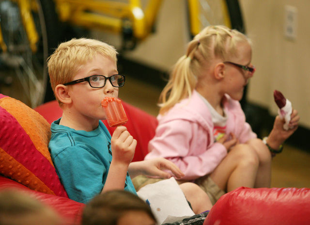 Jack Rocco, left, and Kristlynn Allison eat fruit bars during a Descriptive Video Service movie session at Summer Discovery Days camp at the Nevada Blind Children's Foundation, 9330 W. Martin Ave. ...