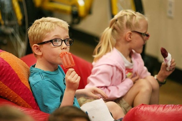 Jack Rocco, left, and Kristlynn Allison eat fruit bars during a Descriptive Video Service movie session at Nevada Blind Children's Foundation Thursday, June 26, 2014, in Las Vegas. The session is  ...