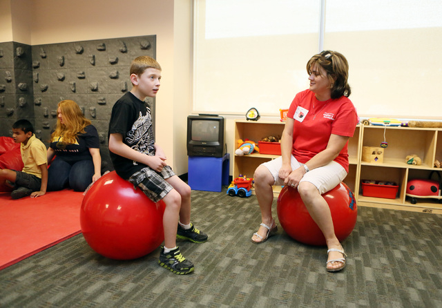 Davian Davis, left, bounces alongside Maricela Garcia during an activity at the summer camp at the Nevada Blind Children's Foundation, June 26. (Ronda Churchill/View)