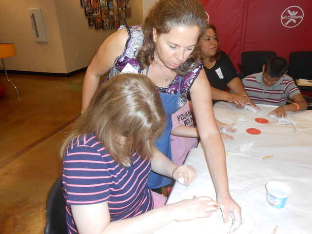 Lea Lucibella teaches an art class June 23 at summer camp at the Nevada Blind Children's Foundation. This day's lesson was using modeling clay to create bowls. Volunteers stood behind the childr ...