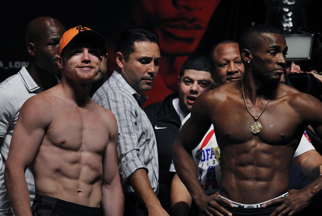 Boxers Saul Canelo Alvarez, left, and Erislandy Lara pose together during the official weigh in for their upcoming fight at the MGM Grand Garden Arena in Las Vegas on Friday, July 11, 2014.(Jason  ...