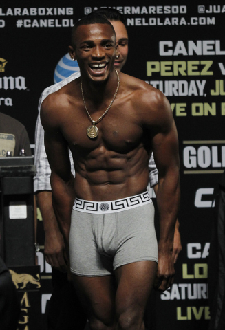 Boxer Erislandy Lara laughs during the official weigh in for his upcoming fight against Saul Canelo Alvarez at the MGM Grand Garden Arena in Las Vegas on Friday, July 11, 2014.(Jason Bean/Las Vega ...