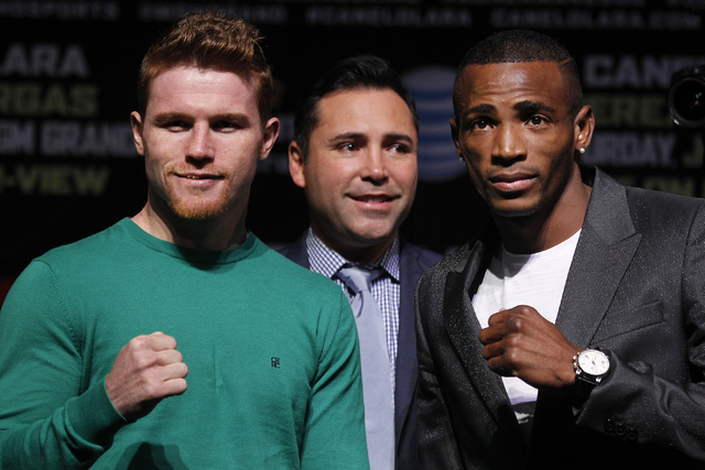 Fighters Saul Canelo Alvarez, left, and Erislandy Lara pose during the pre-fight press conference prior to their fight at the MGM Grand in Las Vegas on Thursday, July 10, 2014.  Golden Boy Promoti ...