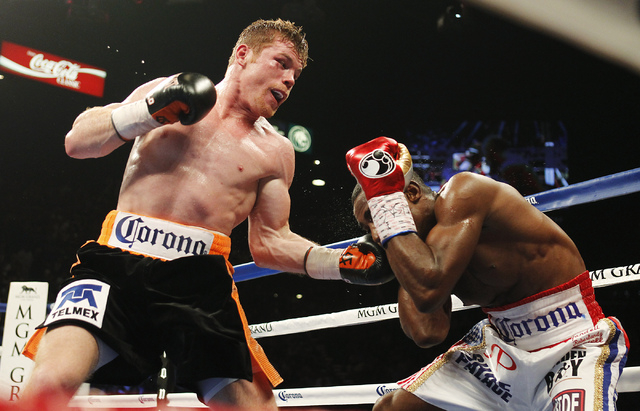 Saul Canelo Alvarez, left, hits Erislandy Lara during their Super Welterweight fight at the MGM Grand Garden Arena in Las Vegas on Saturday, July 12, 2014.(Jason Bean/Las Vegas Review-Journal)