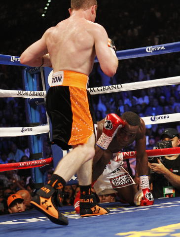 Saul Canelo Alvarez knocks down Erislandy Lara during the ninth round of their Super Welterweight fight at the MGM Grand Garden Arena in Las Vegas on Saturday, July 12, 2014.(Jason Bean/Las Vegas  ...