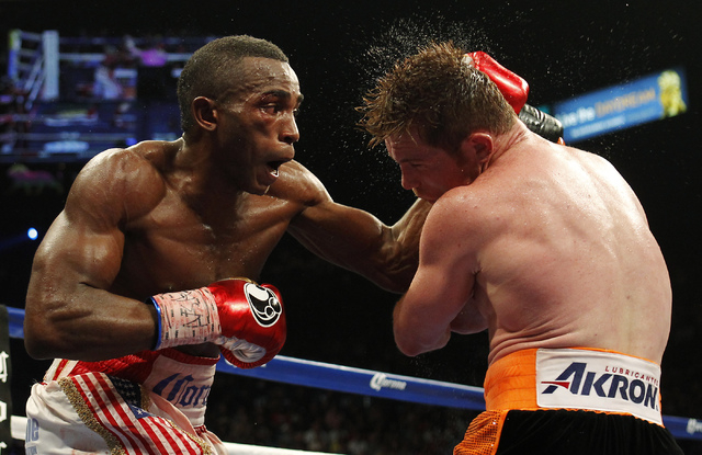 Erislandy Lara, left, hits Saul Canelo Alvarez during their Super Welterweight fight at the MGM Grand Garden Arena in Las Vegas on Saturday, July 12, 2014.(Jason Bean/Las Vegas Review-Journal)