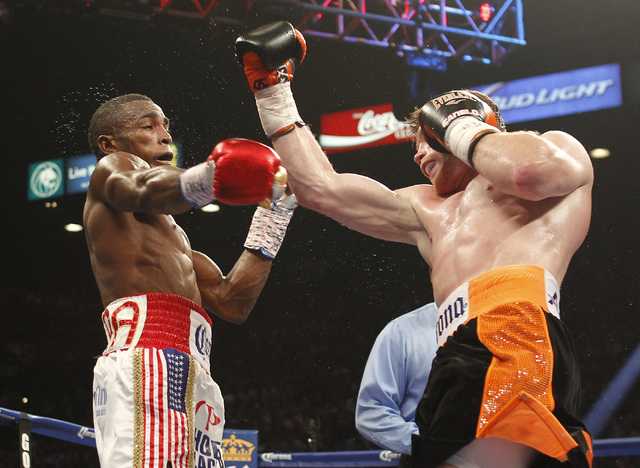 Saul Canelo Alvarez, right, and Erislandy Lara exchange blows during their Super Welterweight fight at the MGM Grand Garden Arena in Las Vegas on Saturday, July 12, 2014.(Jason Bean/Las Vegas Revi ...
