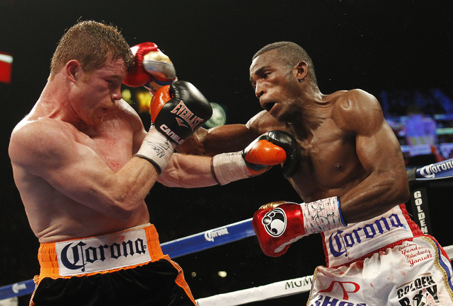 Erislandy Lara, right, hits Saul Canelo Alvarez during their Super Welterweight fight at the MGM Grand Garden Arena in Las Vegas on Saturday, July 12, 2014.(Jason Bean/Las Vegas Review-Journal)