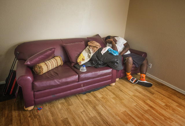"James ""Bubba"" Dukes naps at the family's new apartment near Sam's Town on  Wednesday, March 19, 2014. The family fled their previous apartment after a neighbor was brutally murdered and their apar ..."