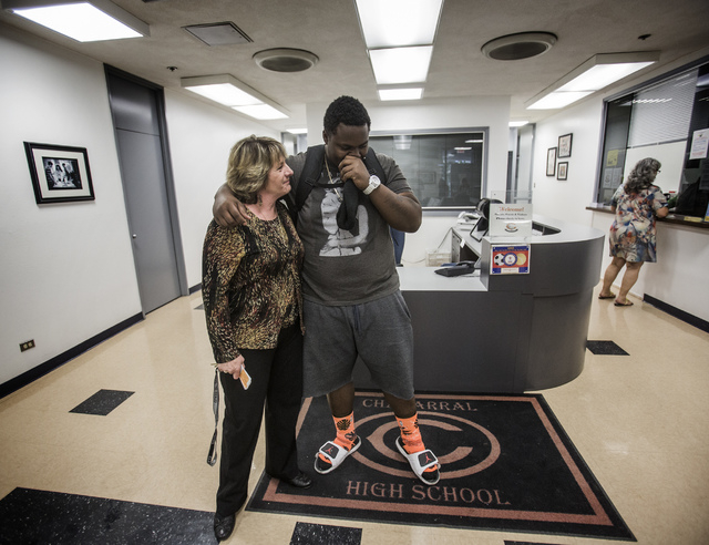"Chaparral High School transition counselor secretary Loretta Tucker embraces James ""Bubba"" Dukes in the school's administrative office on Thursday, April 10,2014. (Jeff Scheid/Las Vegas  ..."