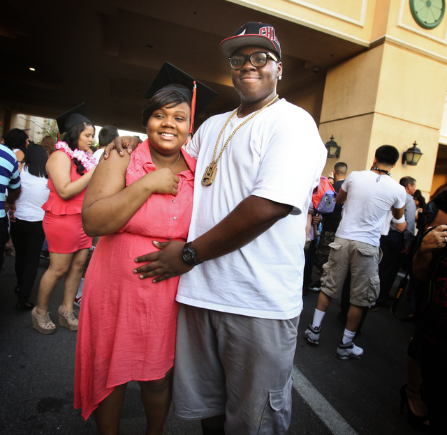 """James """"Bubba"""" Dukes,right, and his girlfriend Dajee Hill after her graduation ceremonies at The Orleans Arena on June 8, 2013. She was six months pregnant at the time. (Jeff Scheid/Las Vegas Revie ..."""
