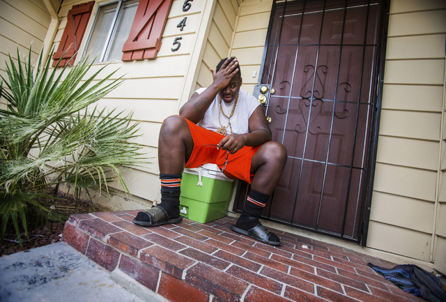 """James """"Bubba"""" Dukes sits outside the home of his girlfriend's mother on Friday, Aug. 16, 2013. It was hitting him that he will become a father soon. (Jeff Scheid/Las Vegas Review-Journal)"""