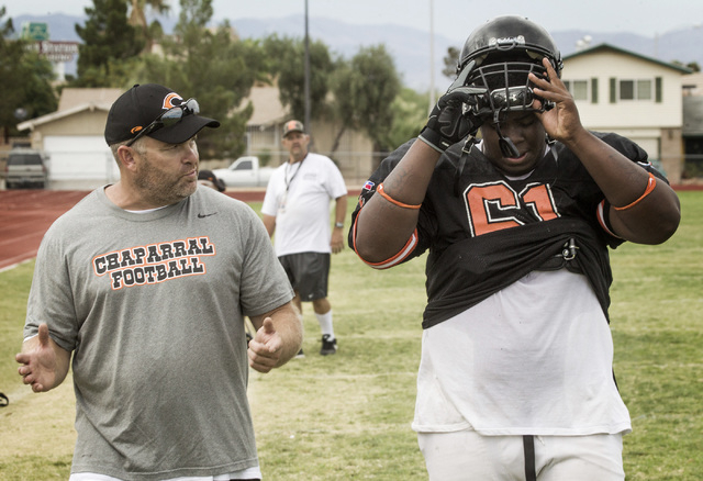 """Chaparral High School football coach Bill Forman talks to James """"Bubba"""" Dukes during practice after the first day of school on Monday, Aug. 26, 2013. (Jeff Scheid/Las Vegas Review-Journal)"""