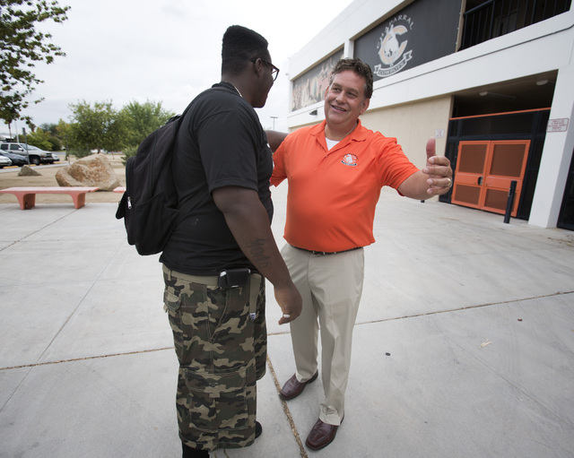 """Chaparral High School principal Dave Wilson embraces James """"Bubba"""" Dukes on the first day of school on Monday, Aug. 26, 2013. Dukes was thirty minutes late because he overslept. (Jeff Scheid/Las V ..."""