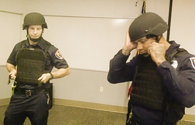 Clark County firefighters Eric Nichols, left,  and Doniel Leak (cq) model ballistic protective vests and helmets the fire department has received on Thursday, July 10, 2014.  The gear will aid fir ...