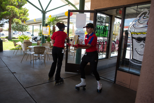 Sonic Drive-In's carhops Meagan Carney, left, and Dominique Corona skate around each other at the 7390 W. Cheyenne Ave. location Friday, July 11, 2014. (Samantha Clemens-Kerbs/Las Vegas Review-Jou ...