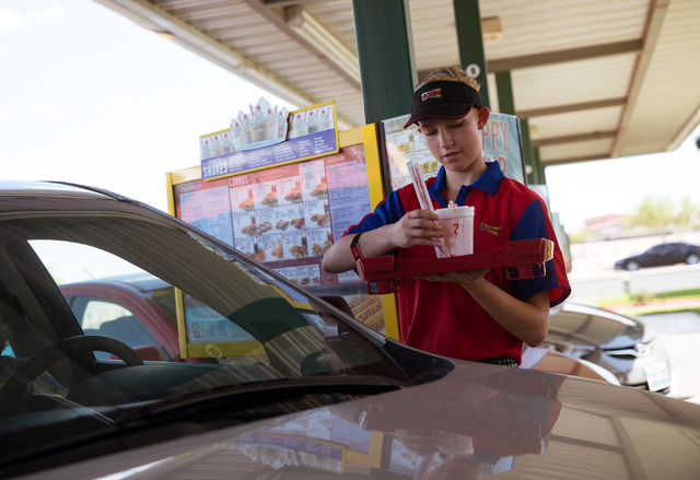 Sonic Drive-In's carhop Angela Galindo delivers food at the 7390 W. Cheyenne Ave. location Friday, July 11, 2014. (Samantha Clemens-Kerbs/Las Vegas Review-Journal)