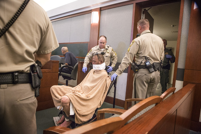 Scott Carmitchel makes his first appearance in  Regional Justice Center on Wednesday, July 30, 2014. Carmitchel was  is facing charges of battery, grand larceny, burglary and robbery with a deadly ...