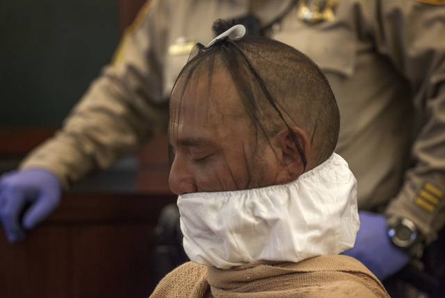 Scott Carmitchel makes his first appearance in  Regional Justice Center on Wednesday, July 30, 2014. Carmitchel had a spit mask wrapped around his face. He is facing charges of battery, grand larc ...