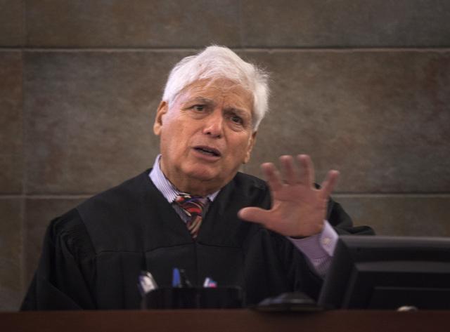 Senior District Court Judge Joseph Bonaventure during arraignment for Scott Carmitchel   Regional Justice Center on Wednesday, July 30, 2014. Carmitchel is facing charges of battery, grand larceny ...