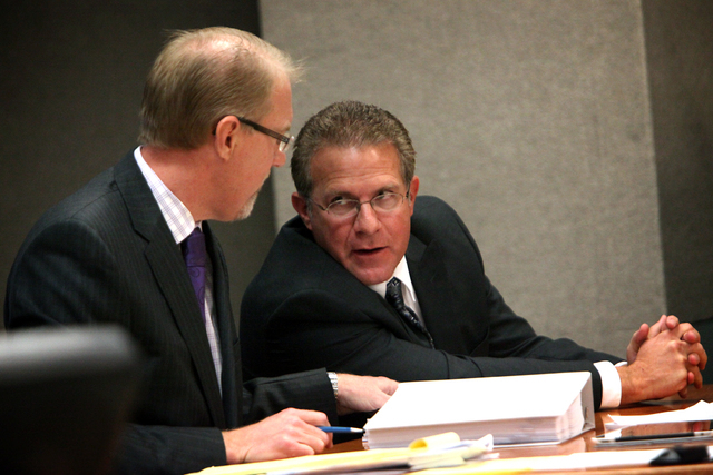 Wade Wagner, right, talks with his attorney Todd Bice in District Judge Susan Scann's court in Las Vegas on Wednesday, Nov. 30, 2011. Judge Scann upheld North Las Vegas election results that showe ...