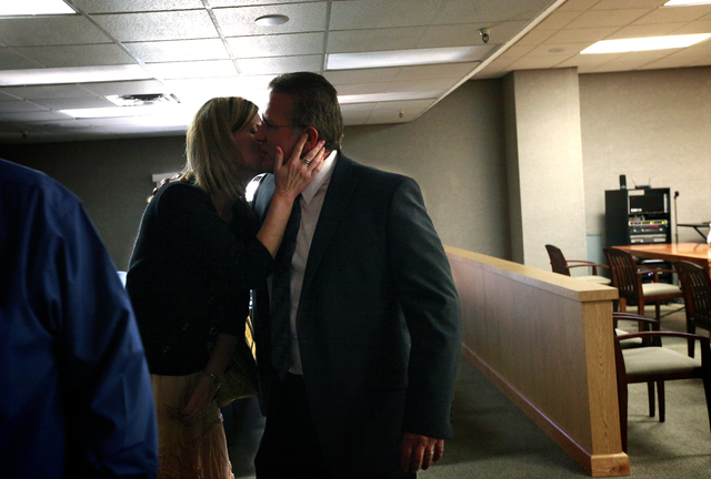 Wade Wagner, right, embraces his wife Rebecca after Judge Susan Scann upheld North Las Vegas election results that showed he defeated former Councilman Richard Cherchio by one vote in Las Vegas on ...