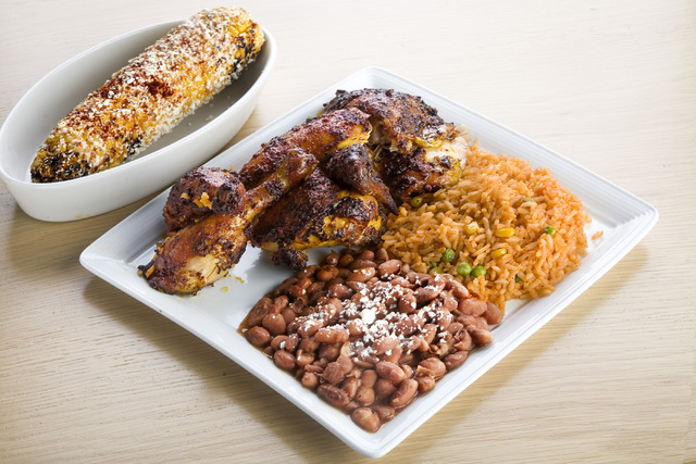 The Commissary offers rostisserie chicken with a side of Mexican rice and pinto beans as well as Mexican street corn. (Jeferson Applegate/Las Vegas Review-Journal)