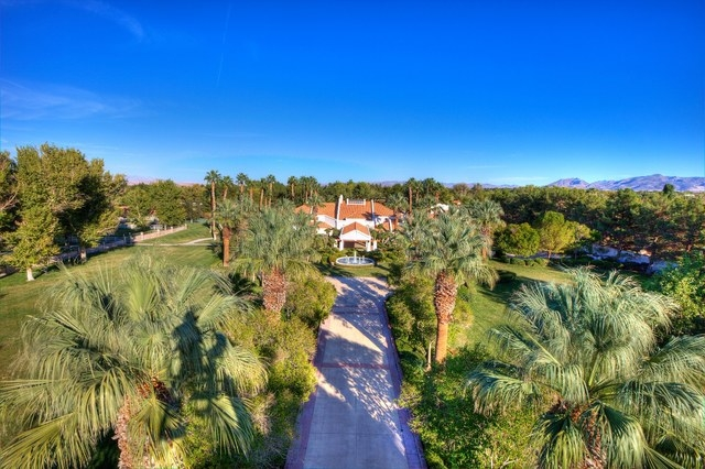 Courtesy photo The gated  Primm estate has a circular driveway.