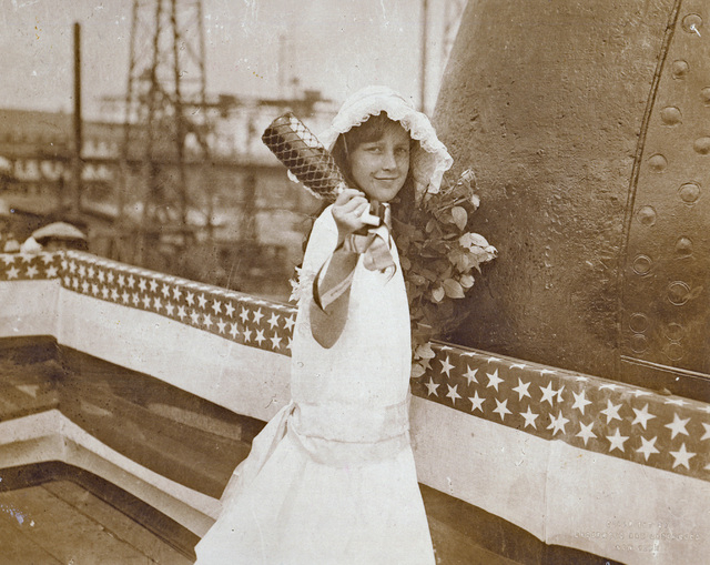 In a photo provided by the Nevada State Museum, Eleanor Ann Siebert, 10, the niece of Nevada Gov. Tasker Oddie, prepares to christen the battleship USS Nevada during a ceremony at Quincy, Mass., o ...